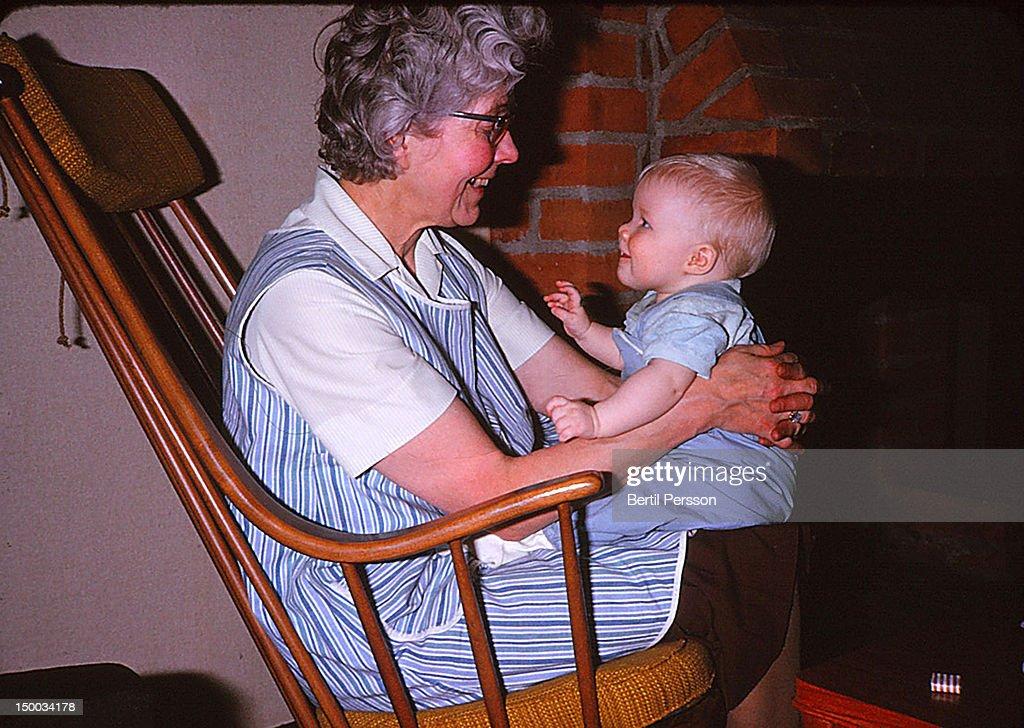 Sitting on grandma's lap : Stock Photo
