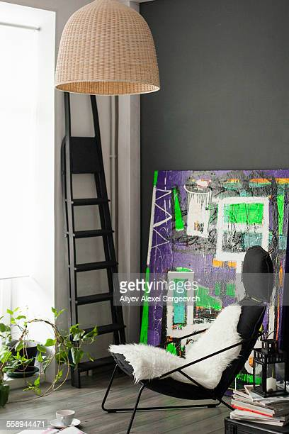 Sitting room with vintage styled armchair and abstract painting