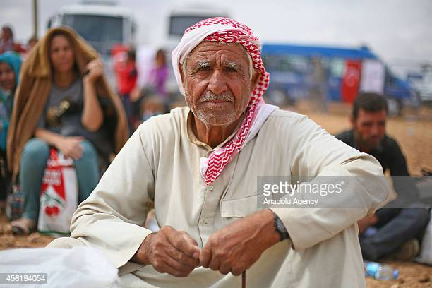 A sitting Syrian Kurdish old man looks around as a group of Syrian Kurds fled from the clashes between Islamic State of Iraq and the Levant and...