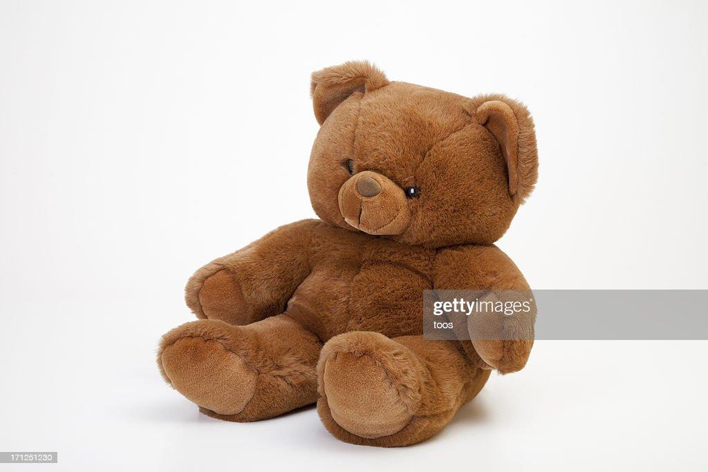 'Sitting Teddybear, isolated on white'