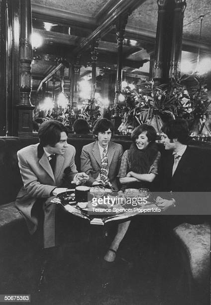 Sitting together at the Salisbury lunching pub table are models Michael Williams Ossie Clark Julie Cooke and Niel Winterbottom