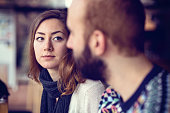 Couple sitting in a café and looking at each other