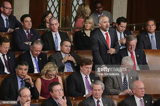 Sitting with fellow members of the farright Freedom Caucus Rep Tim Huelskamp stands to cast his vote for Rep Paul Ryan during the balloting for the...