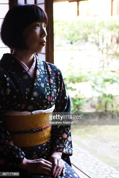 Sitting woman in kimono