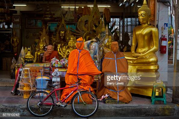 Thailand - Bangkok - Shops selling assorted Buddhist figures on Bamrung Muang...