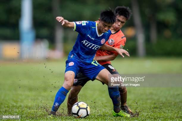 Siu Kwan Cheng of BC Rangers fights for the ball with Chun Ting Law of Sun Bus Yeun Long during the Hong Kong Premier League Week 4 match between BC...