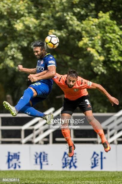 Siu Kwan Cheng of BC Rangers fights for the ball with Tomas Moronesi of Sun Bus Yeun Long during the Hong Kong Premier League Week 4 match between BC...