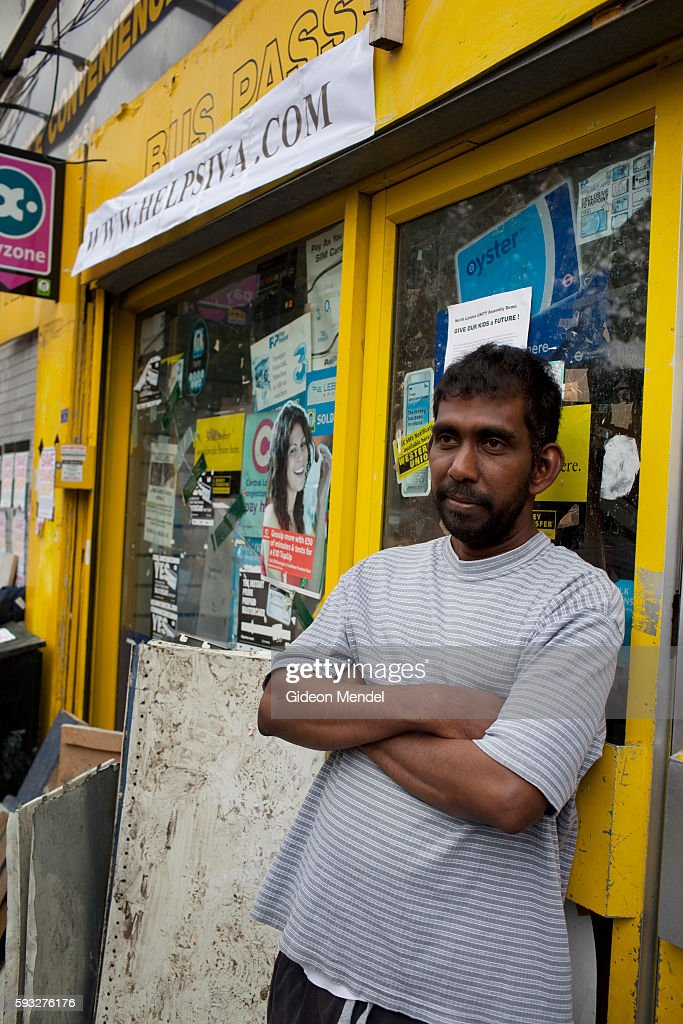 Siva Kandia outside his shop on Clarence Road in Hackney during a community tea party held exactly a week after the violent disturbances involving a...