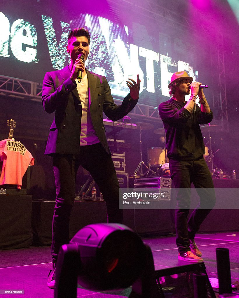 Siva Kaneswaran (L) and Jay McGuiness (R) of the boy band The Wanted perform live at the 97.1 Amplify 2013 Concert at The Hollywood Palladium on April 12, 2013 in Los Angeles, California.