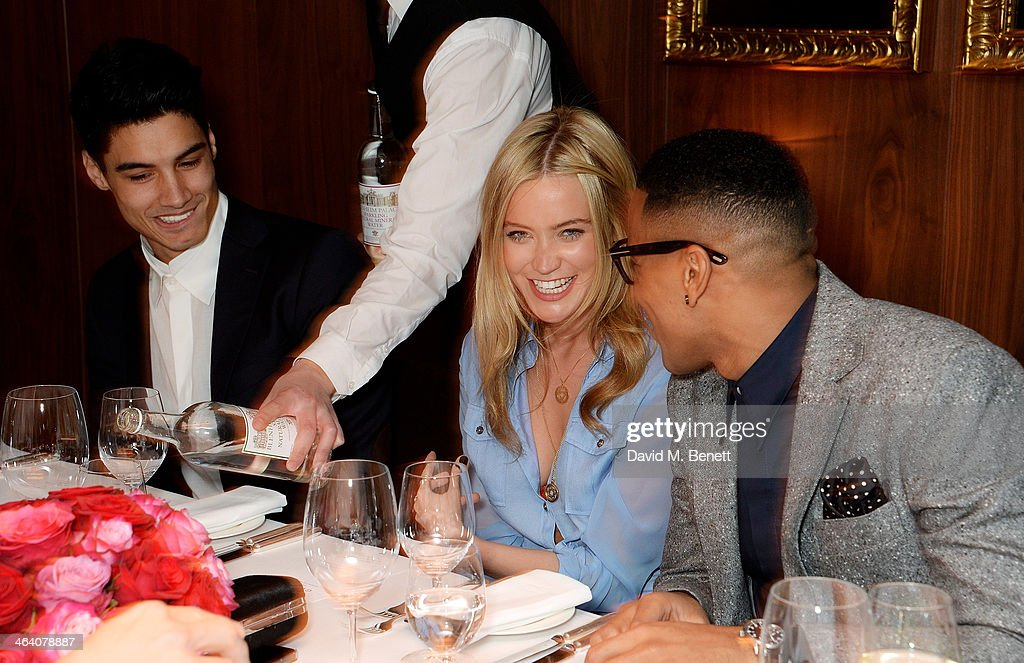 Siva Kaneswaran Laura Whitmore and Reggie Yates attend the 'GUESS Loves Priyanka' VIP Dinner at the London Edition Hotel on January 20 2014 in London...