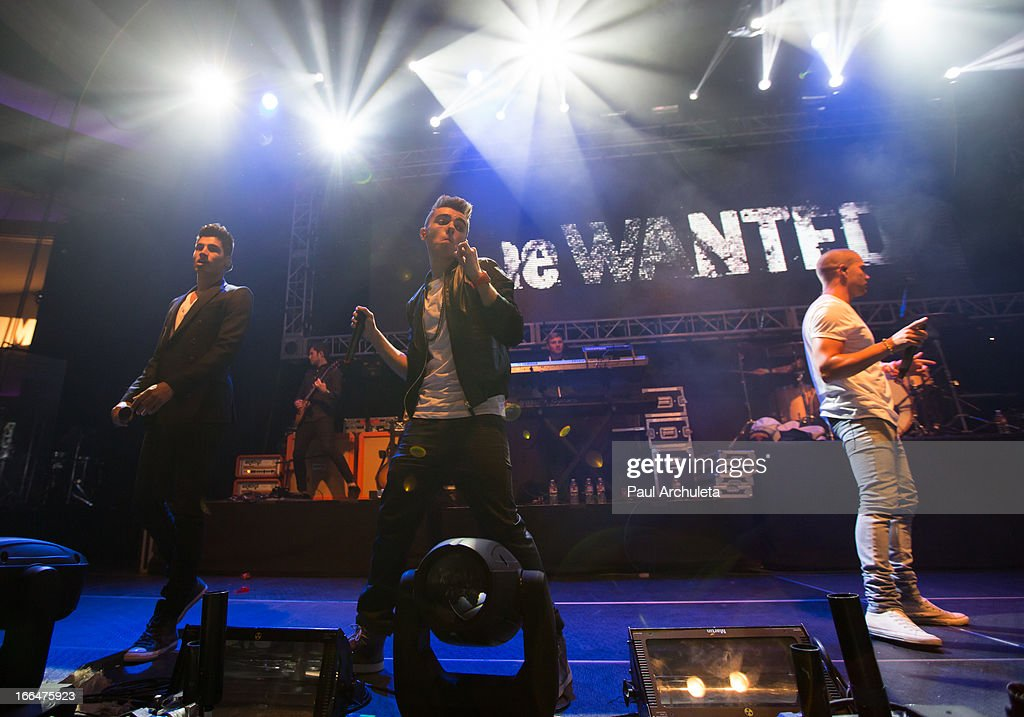 Siva Kaneswaran, Nathan Sykes and Max George of the boy band The Wanted perform live at the 97.1 Amplify 2013 Concert at The Hollywood Palladium on April 12, 2013 in Los Angeles, California.
