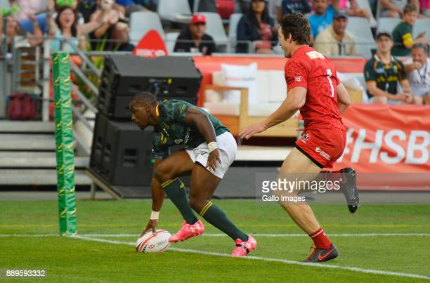 Siviwe Soyizwapi of South Africa scores a try during the 2017 HSBC Cape Town Sevens Bronze Final match between South Africa and Canada at Cape Town...
