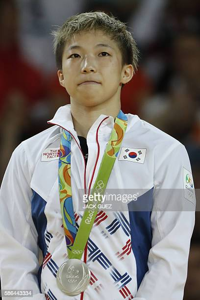 Sivler medallist South Korea's Jeong Bokyeong celebrates on the podium of the women's 48kg judo contest of the Rio 2016 Olympic Games in Rio de...