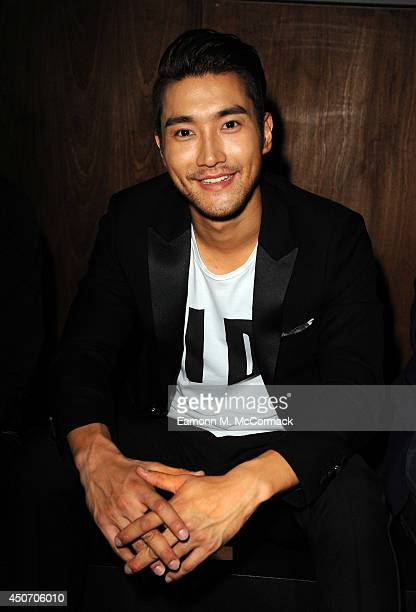 Siwon Choi attends the Jimmy Choo show during the London Collections Men SS15 on June 16 2014 in London England