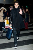 Siwon of South Korean boy band Super Junior is seen at Incheon International Airport on January 10 2013 in Incheon South Korea