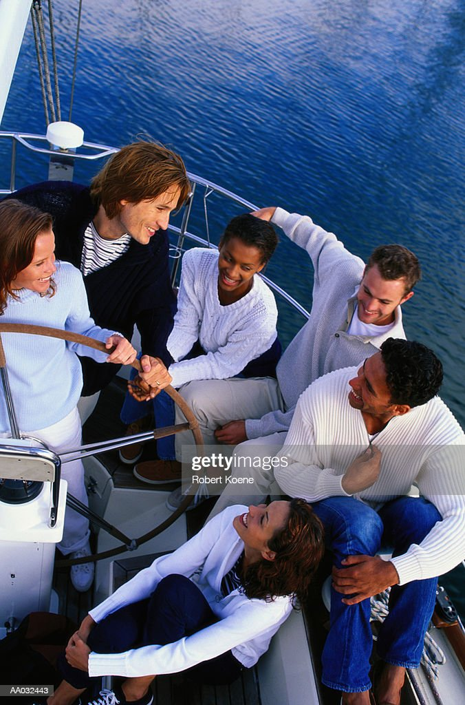 Six Adults Relaxing on a Boat : Stock Photo