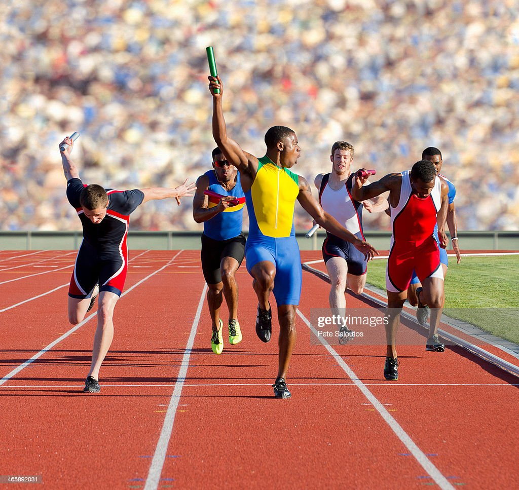 Six athletes running relay race : Stock Photo