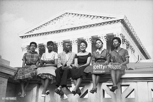Six black children who attended Little Rock's Central High School earlier in 1958 sit outside the Supreme Court in this 8/22/58 photo The NAACP asked...