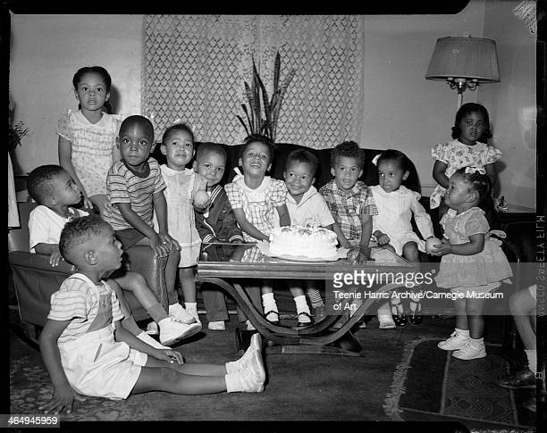 Howard Shepherd seated on floor Pat Austin standing far left Earl Harris second from left seated on arm of chair Lorraine Wright holding ball Rita...