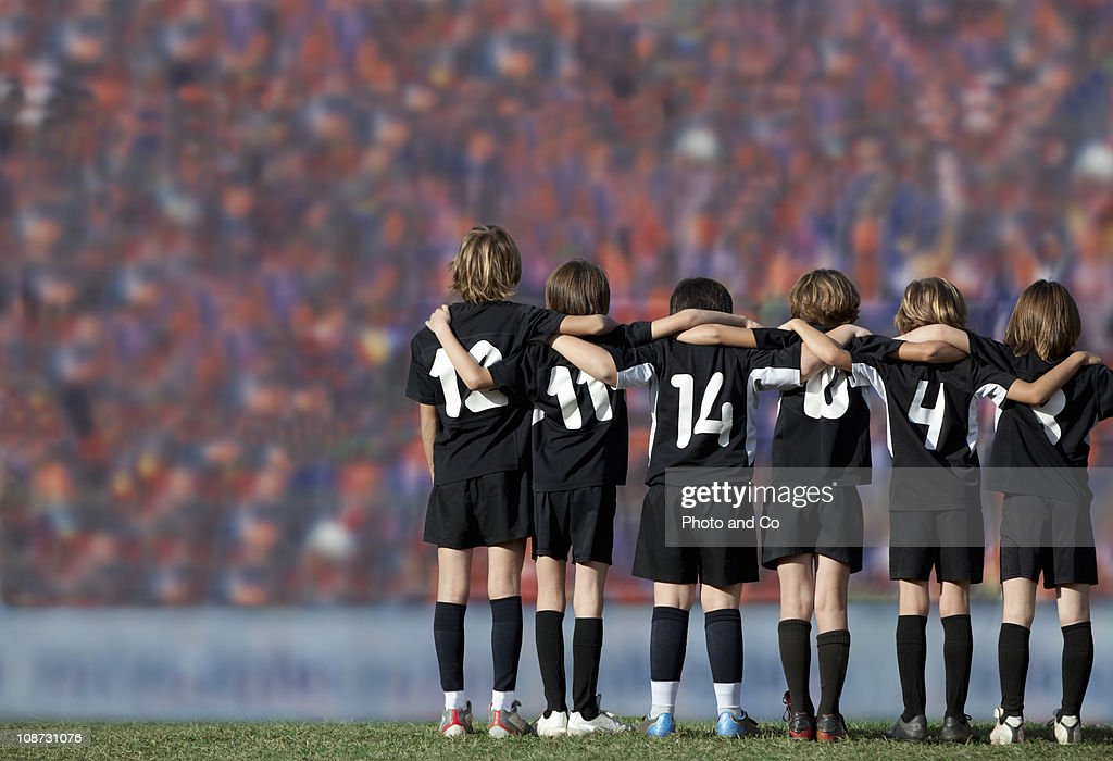 Six boys players (10-11) standing in : Stock Photo