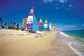 Six catamarans on Ft. Lauderdale beach, Florida, USA