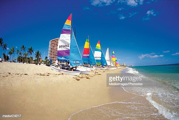 Six catamarans on Ft. Lauderdale beach, Florida, USA