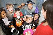 Six children trick or treating on Halloween