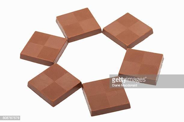 Six chocolate squares creating a hexagon shape