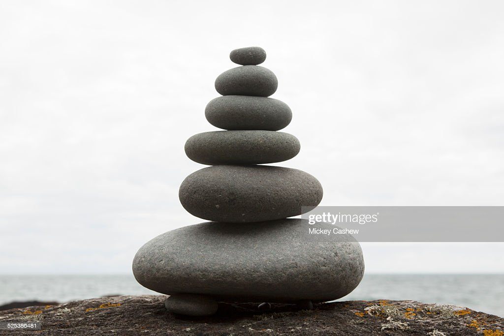 Six coastal stones balanced on top of each other