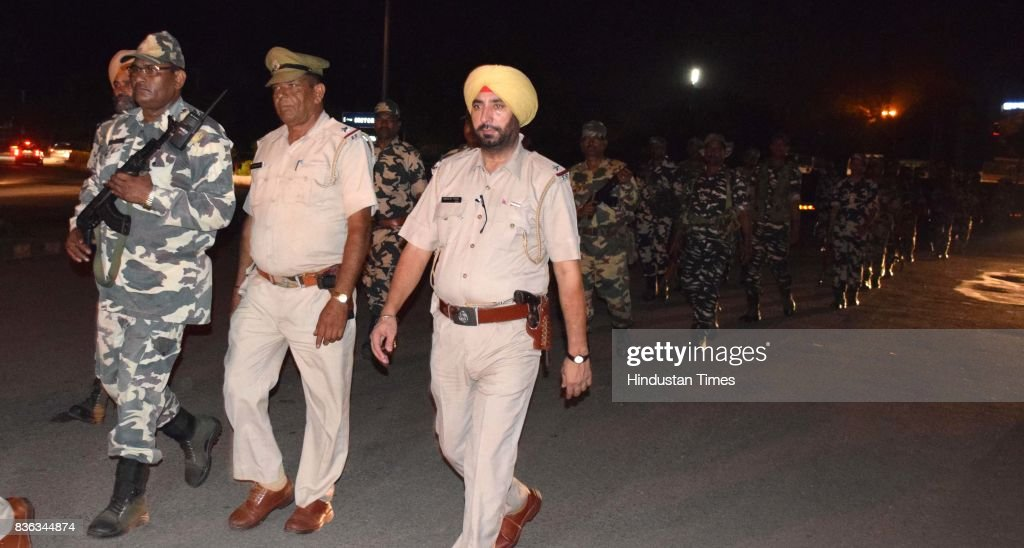 Six companies of CRPF take out a flag march ahead of final hearing of Dera Sacha Sauda Chief Sant Gurmeeat Ram Rahim Singh in the alleged rape case on August 21, 2017 in Panchkula, India. A special CBI (Central Bureau of Investigation) Court in Panchkula will pronounce its verdict on August 25. Police has beefed up the security and 35 companies has been called as Dera followers have started fortification of dera premises and most can be seen patrolling the 6-7 km area of dera perimeter from both sides with a broomstick in hand.