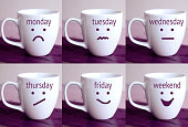 six cups with the words of days of the week and drawn faces