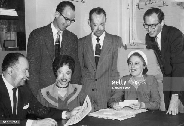 Six defendants in the Communist conspiracy case compare notes before their trial opened left are Arthur Bary Mrs Anna Bary Patricia Blau Joseph...