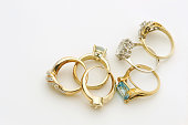 Several gold and silver rings with gemstones  Paper background, off white   [url=/file_closeup.php?id=16236115][img]/file_thumbview_approve.php?size=1&id=16236115[/img][/url] [url=/file_closeup.php?id