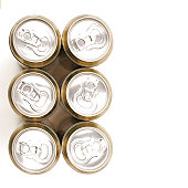 Overhead view of six soft drink or beer ringpull aluminium cans isolated on a white background