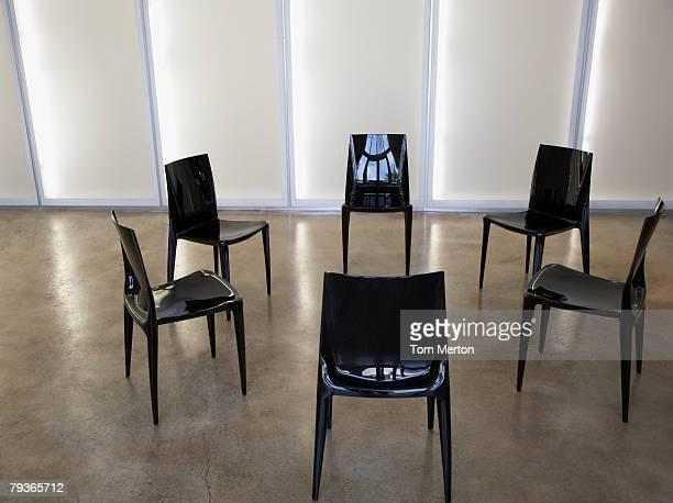 Six empty chairs indoors