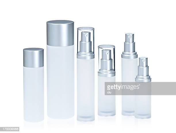Six empty cosmetic bottles
