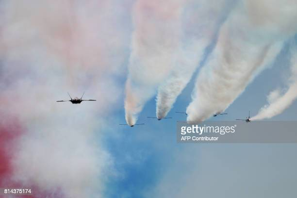 Six F16 and one F22 of the US Air Force fly over during the annual Bastille Day parade in French capital Paris on July 14 2017 The parade on Paris's...