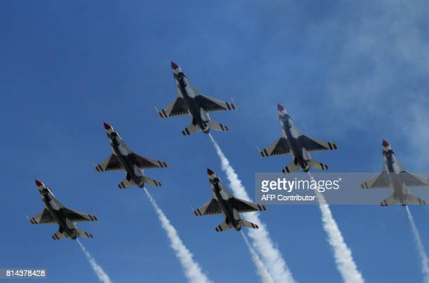 Six F16 of the US Air Force fly over Paris during the annual Bastille Day military parade on the ChampsElysees avenue in Paris on July 14 2017 The...