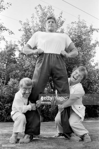 Six foot six inch actor David Prowse who plays Star Wars villain Darth Vader in the famous film trilogy poses with 3 ft8 Kenny Baker and 4 ft 2 inch...