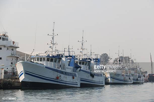 Six Frenchbuilt fishing vessels dock at the Maputo Harbour on May 26 2015 in Maputo part of the latest batch of fishing vessels built at Cherbourg...