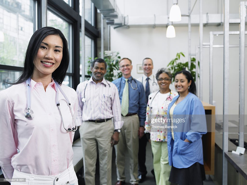 Six healthcare workers, portrait (focus on woman in foreground) : Stock Photo