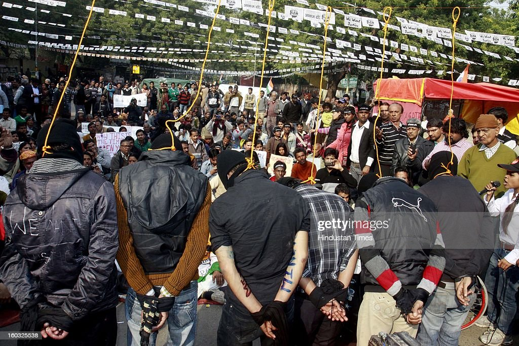 Six men enact a mock hanging during a protest demanding the death penalty for the six men accused of a fatal gang rape of a young woman in New Delhi last month at Jantar Mantar on January 29, 2013 in New Delhi, India.