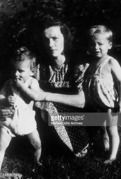 Six month old Arnold Schwarzenegger in the garden with his mother Aurelia and half brother Meinhard in March 1948 in Thal Austria