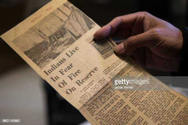 OHSWEKEN ON FEB 17 Six Nations Fire Chief Matthew Miller scans an old newspaper clipping that he keeps in his office for motivation 'Indians Live In...
