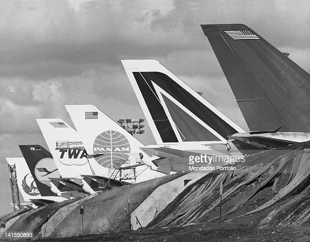 Six new 'Boeing 747' tails being displayed on the embankment of the Boeing Everett Factory waiting to be delivered to their respective air companies...
