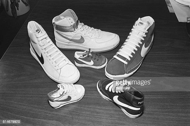 Six Nike sports shoes rest on a table at the company headquarters in Portland Oregon for the unveiling of the 1982 AirForce line of basketball shoes
