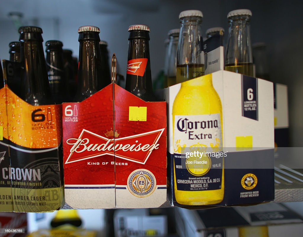 Six packs of Anheuser-Busch's Budweiser and Grupo Modelo's Corona Extra beers sit on a shelf at the Chandi Wine and spirits store on January 31, 2013 in Miami, Florida. Federal authorities filed a lawsuit January 31, to stop the Anheuser-Busch InBev's $20.1 billion takeover of Grupo Modelo.
