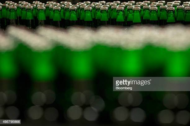 Six packs of Beck's lager beer bottles move along the production line at the Beck's brewery operated by AnheuserBusch InBev NV in Bremen Germany on...