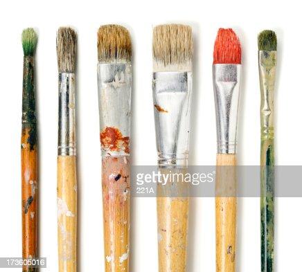 Six paintbrushes on white