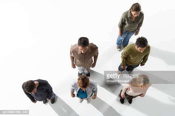 Six people standing in lines